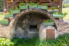 Detail of the wooden house typical in a alps village on Ridnaun Valley/Ridanna Valley - Racines country - near Sterzing/Vipiteno, royalty free stock images