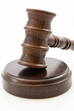 Detail of wooden judge gavel and stand. Wooden judge gavel and wooden stand on a white background Stock Images