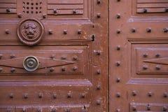 Detail of a wooden medieval door. Closeup detail of a brown textured wooden medieval door Stock Photos