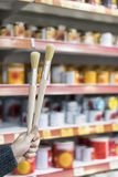 Detail of wooden paint brushes in store with great blur stock images