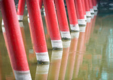 Detail of wooden red bridge with water background. Royalty Free Stock Images