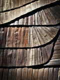 Detail of wooden shingle roof with a tilde Royalty Free Stock Image