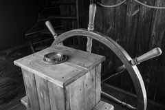 Detail of Wooden Ship Helm with Wheel and Compass Royalty Free Stock Image