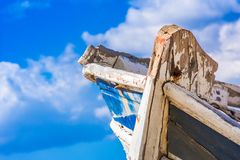 Detail of a wooden shipwreck with cloudy blue sky background. Royalty Free Stock Photos