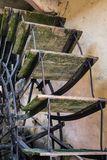 Wooden shovels of an old watermill. Detail of the wooden shovels of an old watermill stock photo