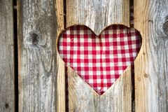 Detail of a wooden toilet hut. Entry door with plaid heart Stock Images