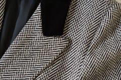 Detail of woolen jacket Herringbone Broken Twill Weave. Detail of  woolen jacket Herringbone Broken Twill Weave with black velvet collar. Closeup Stock Photo