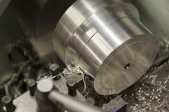 Detail of work at lathe with aluminium metal royalty free stock image