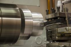 Detail of work at lathe with aluminium metal.  stock photography
