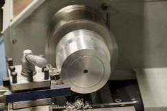 Detail of work at lathe with aluminium metal.  royalty free stock images