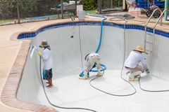Detail work on new pool plaster. Resurfaced Diamond Brite pool detail cleaning Royalty Free Stock Images