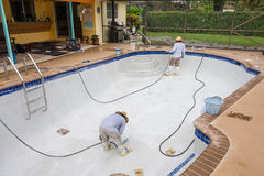 Detail work on new pool plaster. Resurfaced Diamond Brite pool plaster detail cleaning Royalty Free Stock Images