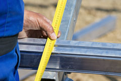 Detail of worker using measure tape Royalty Free Stock Photos