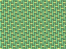 Detail of woven basket. Detail of green and yellow woven basket pattern as a background Royalty Free Stock Images