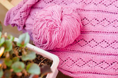 Detail of woven handicraft knit pink sweater Stock Image