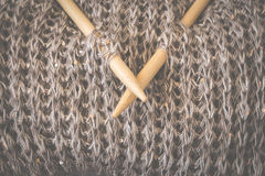 Detail of woven handicraft knit woolen design texture and knitting bamboo needle. Toned retro. Rustic wooden background. Detail of woven handicraft knit woolen royalty free stock photos