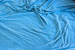 Detail of wrinkled old blanket. Background image of  rumpled old blue blanket covered with soft folds Stock Images