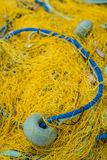 Detail of yellow nets on a boat deck. Closeup of a yellow nets on a fisherman boat deck in Zante Island, Greece stock image