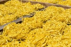Detail of yellow noodles drying. Sumatra Royalty Free Stock Image