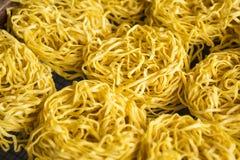 Detail of yellow noodles drying. Sumatra Royalty Free Stock Photos