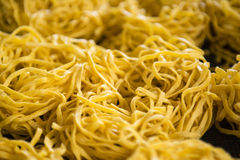 Detail of yellow noodles drying. Sumatra Stock Images