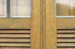Detail of yellow painted wooden window. Of old worker village house in Sao Paulo, Brazil Royalty Free Stock Image