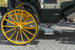 Detail of yellow wheel of horse carriage in Seville Spain Royalty Free Stock Photos