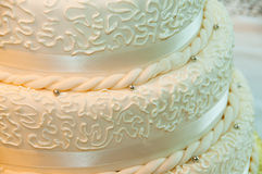 Wedding Cake Close up. Detail of yellow white wedding or anniversary cake Royalty Free Stock Photos
