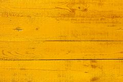 Detail of yellow wooden fence Royalty Free Stock Image