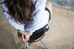 Detail young female hands tied wrist with rope Royalty Free Stock Photography