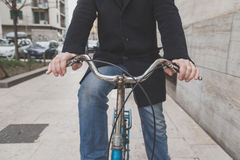 Detail of a young man posing with his bicyle Royalty Free Stock Photos