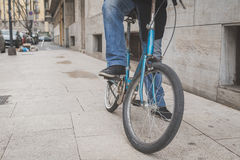Detail of a young man posing with his bicyle Stock Image