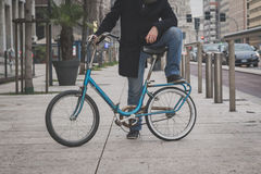 Detail of a young man posing with his bicyle Stock Images