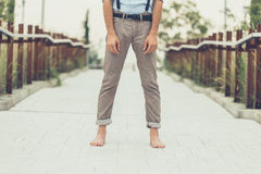 Detail of a young man posing in an urban context Stock Images