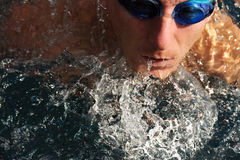Detail of young man swimming Stock Image