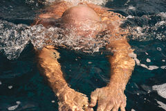 Detail of young man swimming Royalty Free Stock Image
