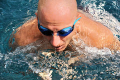 Detail of young man swimming Royalty Free Stock Photography