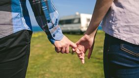 Unrecognizable couple holding hands with hooked fingers. Detail of young unrecognizable couple holding hands with hooked fingers outdoors royalty free stock photo