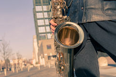 Detail of a young woman with her saxophone Royalty Free Stock Photography