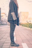 Detail of a young woman posing in the city streets Royalty Free Stock Image
