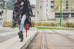 Detail of a young woman posing in the city streets Royalty Free Stock Images