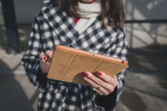 Detail of a young woman using her tablet in the city streets Stock Image