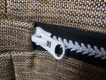 Detail of a zipper on a fabric. A detail of a zipper on a fabric Stock Photography