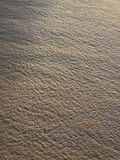 Detailed Abstract Pattern of Sand on Shore near Ocean Royalty Free Stock Photos