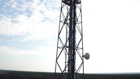 Detailed aerial view of telecommunication repeater antenna system, outdoor repeater base station stock footage