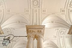 Detailed arch and column decoration, sommerset house, london. Partial view of carved ceiling and decorated victorian columns, sommerset house, london, uk royalty free stock photo