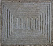 Detailed background of gray carpet with a pattern in the form of a square. Detailed background of gray carpet with a pattern in the form of a square stock photography