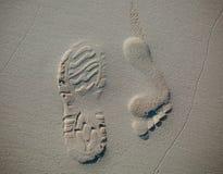 Detailed bare human footprint on the beach sand Stock Photos