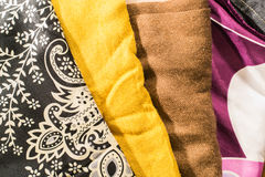 Detailed black, white, yellow, brown and magenta clothes Stock Photography