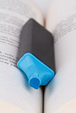 Detailed Blue Higlighter Pen. Close up detailed front view of blue highlighter pen on paper Royalty Free Stock Image
